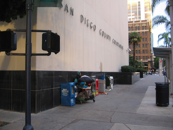 Someone camped against the San Diego County Courthouse. The number of homeless people downtown continues to grow.