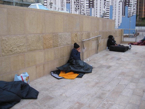 The relatively new Horton Plaza Park now attracts many homeless. A sad situation with no easy solution.