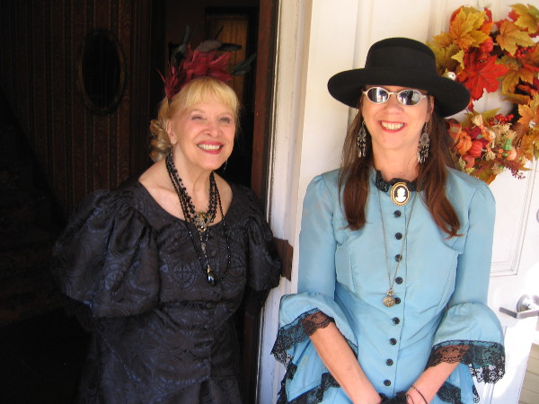 Two ladies smile for my camera at the front door of the historic William Heath Davis House in San Diego's Gaslamp.