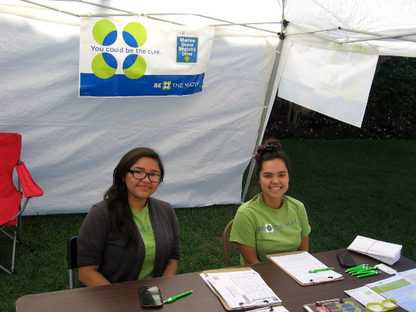 You could be the cure! Smiling ladies in Balboa Park register potential bone marrow donors. And there are other ways that you can fight cancer, too!