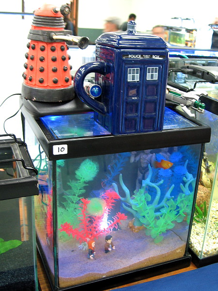 Dr. Who and a companion have traveled by TARDIS into the strange unearthly interior of this humorous aquarium.