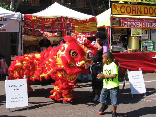 Fourth Avenue runs through San Diego's Chinatown, which is officially called the Asian Pacific Thematic Historic District. A colorful lion dancer turns heads at the Fall Back Festival.