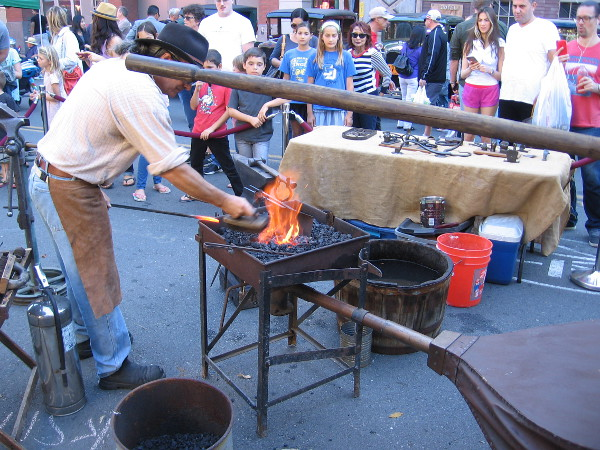 A blacksmith attracted a big crowd on Island Avenue in San Diego's Gaslamp Quarter.