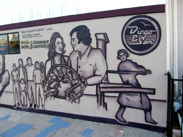 The mural is titled Que Viva Barrio Logan, by artist Mario Torero. It's painted on the side of Diego and Son Printing. Making a difference in our community.