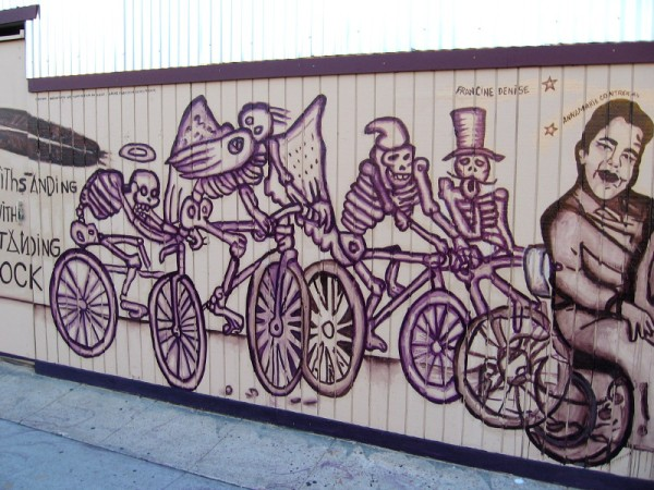 Skeletons on bicycles. Symbols, I believe, of past loved ones.