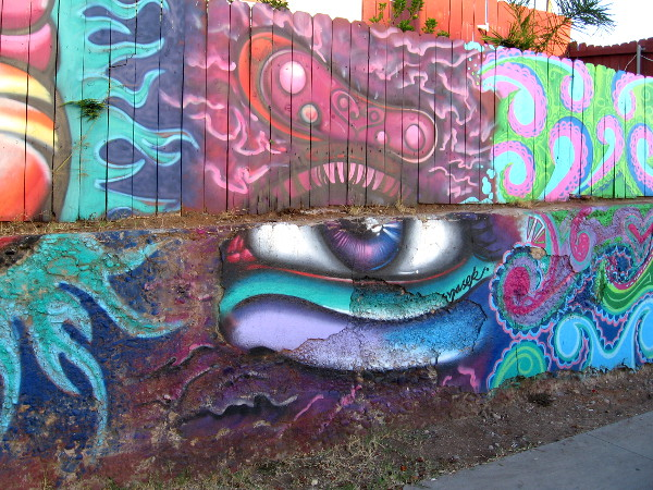 A large eye watches Evans Street, a block southeast of Chicano Park.