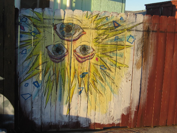Three eyes in a blazing sun, which shines from The Nest Murals in Barrio Logan.