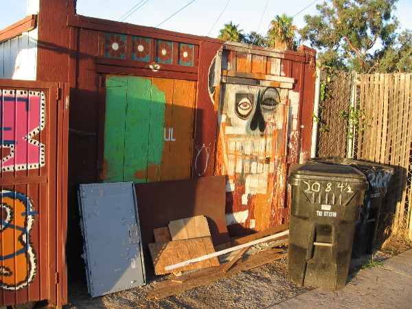 A face with odd geometric features in the Barrio Logan alley.