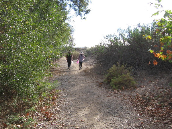 A couple walks slowly along the Kumeyaay Nature Trail, enjoying a beautiful November day.
