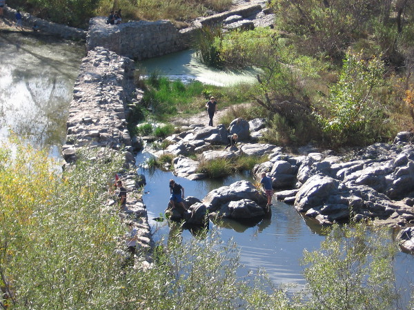Families play on the rocks near the Old Mission Dam at Mission Trails Regional Park.