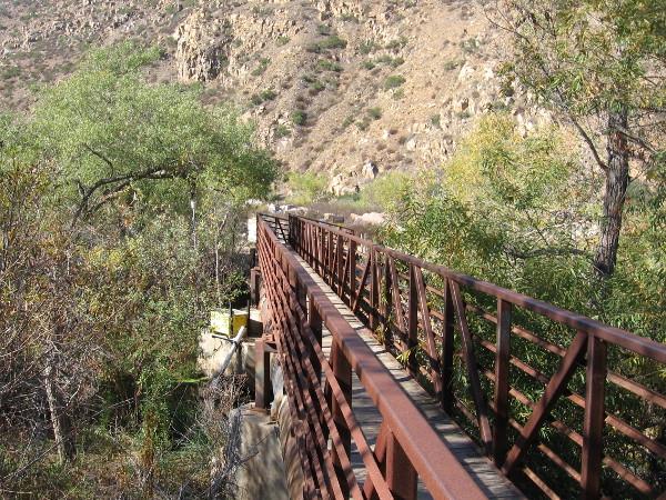 Crossing the San Diego River via a steel footbridge.