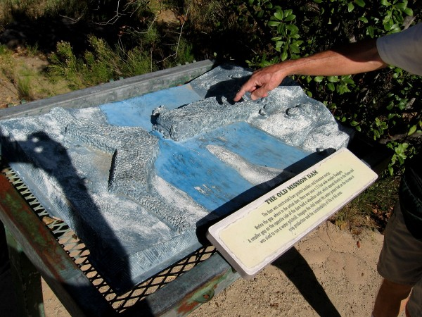 A cool 3-D model of the Old Mission Dam beside the trail. The dam was constructed from granite boulders and limestone mortar. At the gap there was a 12-foot wide floodgate.