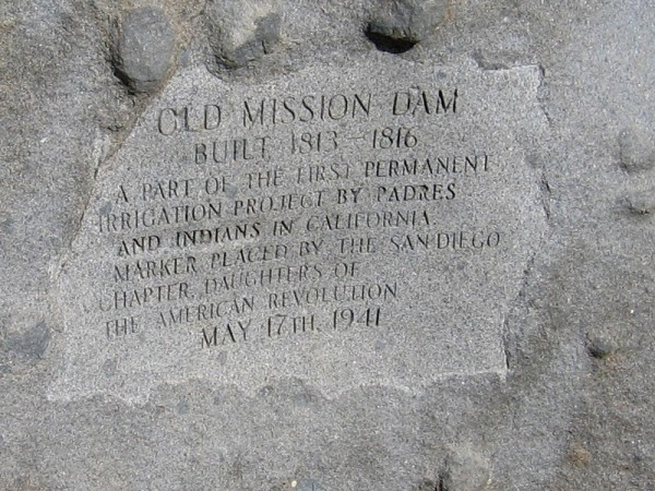 Inscription in a boulder dated 1941, by the Daughters of the American Revolution. OLD MISSION DAM. Built 1813-1816. A part of the first permanent irrigation project by Padres and Indians in California.