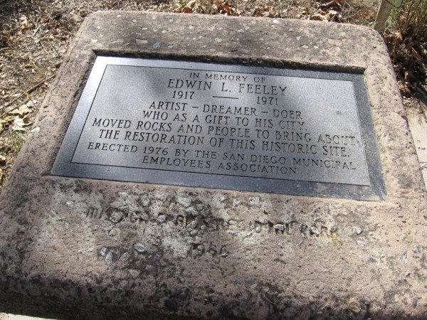 A plaque by the old dam. In memory of Edwin L. Feeley. 1917 - 1971. Artist - Dreamer - Doer who as a gift to his city, moved rocks and people to bring about the restoration of this historic site.