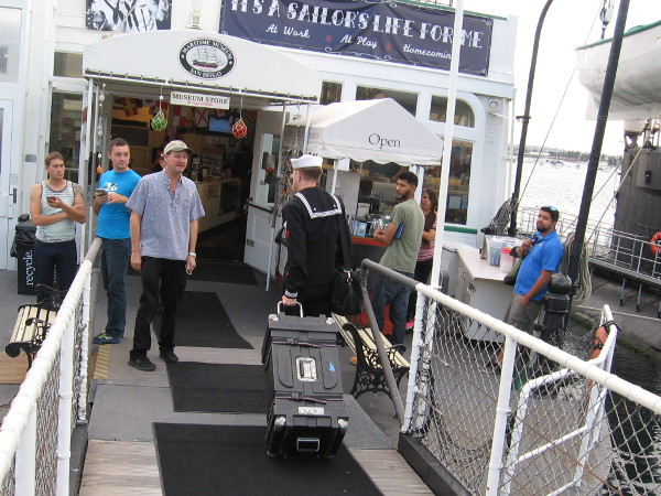 A member of the Navy Band enters the Berkeley steam ferry for a special Saturday evening event at the Maritime Museum.