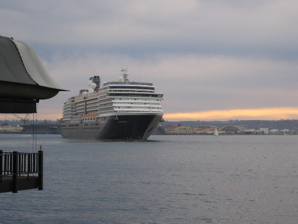 A cruise ship slowly turns, preparing to depart San Diego.