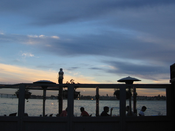Silhouetted evening diners at the Pier Cafe.