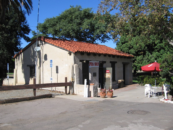 Photo of the small, historic adobe across the parking lot of the Presidio Hills Golf Course. Built around 1810, it's the oldest structure that is still standing in San Diego.
