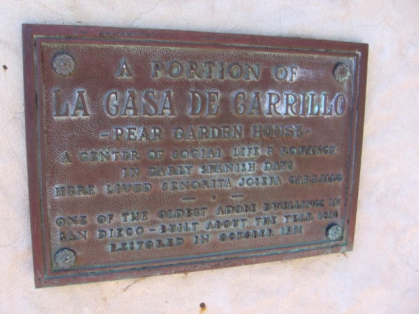 A portion of La Casa De Carrillo - Pear Garden House. A center of social life and romance in early Spanish days. Here lived Senorita Josefa Carrillo. One of the oldest adobe dwellings in San Diego. Built about the year 1810. Restored in October 1931.