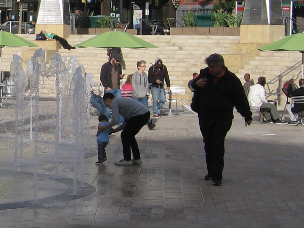 But there is also hope, and the potential for joy. A child is shown the dancing fountain at the center of Horton Plaza Park.