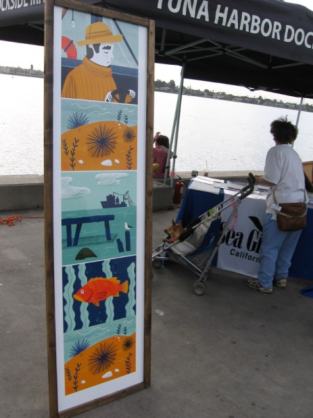 Some colorful artwork at the fresh fish market depicts a fisherman and scenes from above and beneath the ocean.
