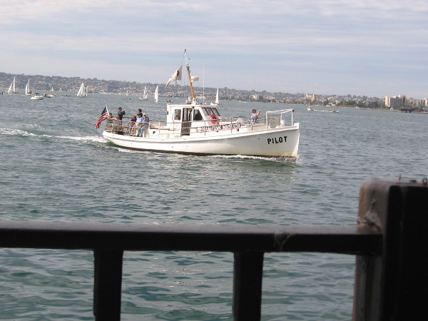 Here comes the Maritime Museum of San Diego's historic Pilot boat, out on a harbor tour. Those sailboats racing in the distance belong to the San Diego Yacht Club.