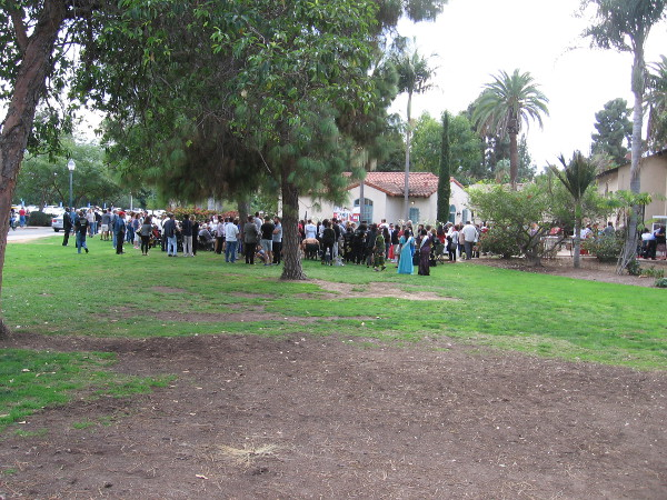 Two cottages will be built in this area, north of the House of Iran and the Hall of Nations Building. In this photo a crowd is gathering for the historic groundbreaking ceremony.