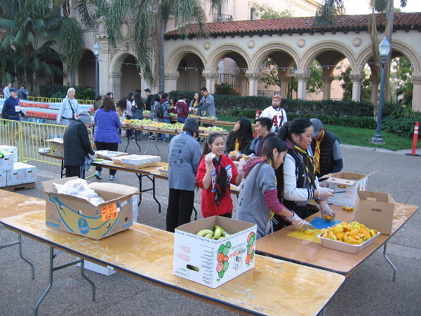 Energy-providing fruit slices are prepared for 5K participants before the beginning of the race.