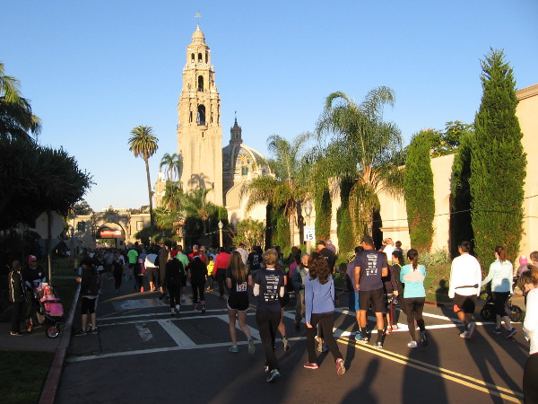 Runners and walkers head toward the start line in Balboa Park.