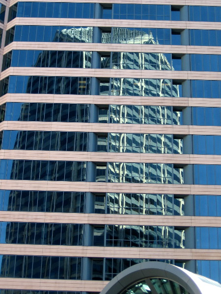 One America Plaza, San Diego's tallest building, seen in a grid of windows across Broadway.