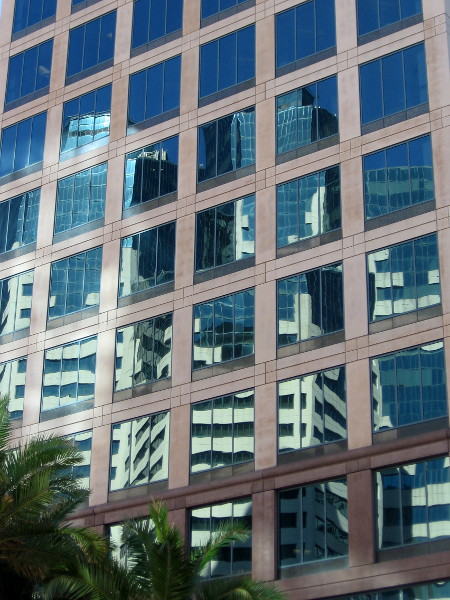 San Diego's distinctive Emerald Plaza reflected in the windows of 501 W. Broadway.
