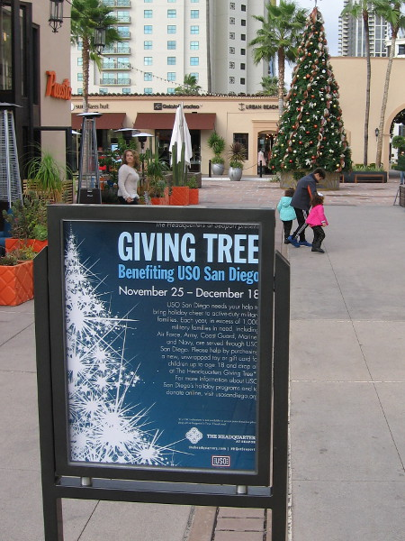 A Christmas tree in a shopping center. It is a giving tree.