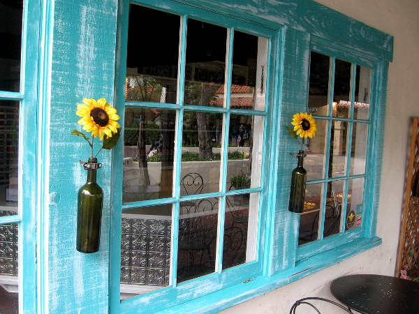 Sunflowers and blue window frames at Frost Me Gourmet Cupcakes in Seaport Village.