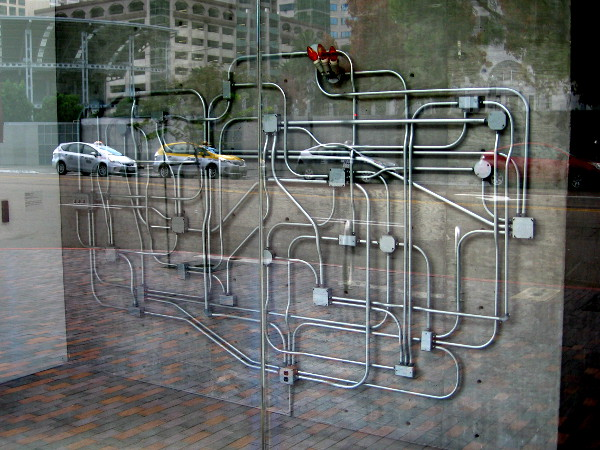 A crazy tangle of electrical lines in the entrance of the David C. Copley Building in downtown San Diego.