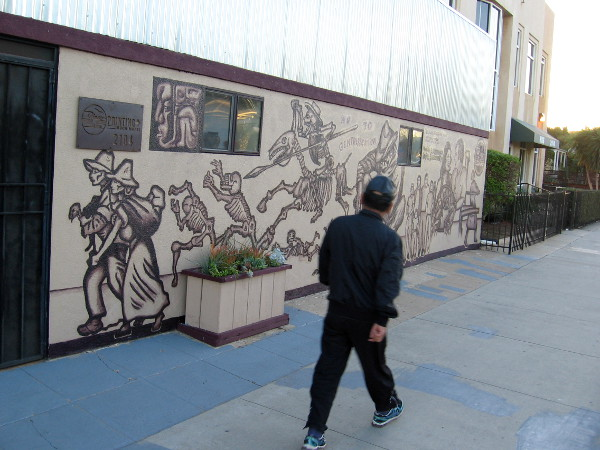 Walking down the National Avenue sidewalk, past a new mural that celebrates life, memory and history in Barrio Logan.