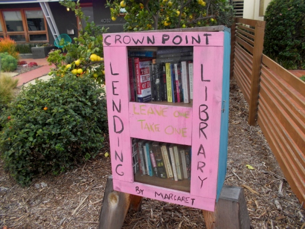 A simple, homemade lending library box next to somebody's front yard in Crown Point, a neighborhood on Mission Bay. Leave a book or take one!