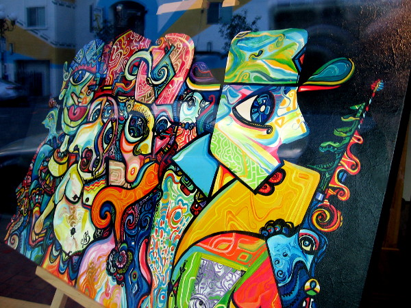 Unexpected faces in the window of Sparks Gallery in the Gaslamp Quarter. This colorful work of art commands the attention of those passing down the sidewalk.