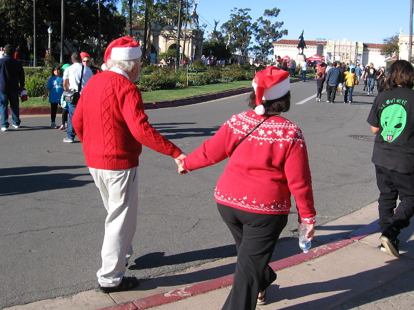 This might be Santa and Mrs. Claus walking happily through Balboa Park during 2016 December Nights. At least, there's a good chance. Right?