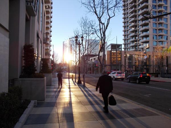 A businessman walks to work in downtown San Diego.