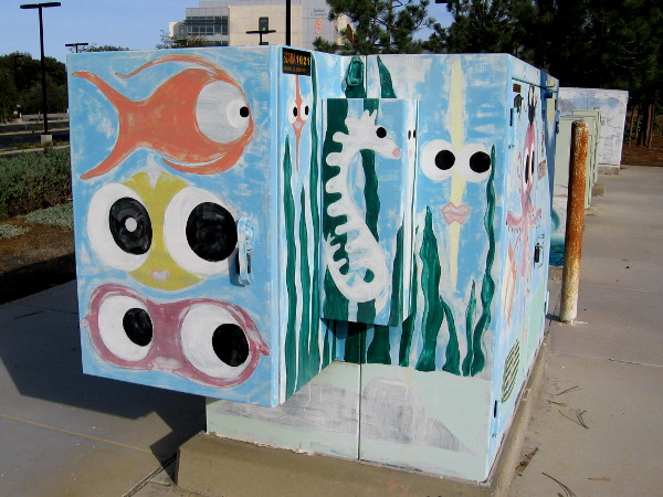 Electrical box on North Torrey Pines Road near the gliderport intersection features colorful fish with huge eyeballs!