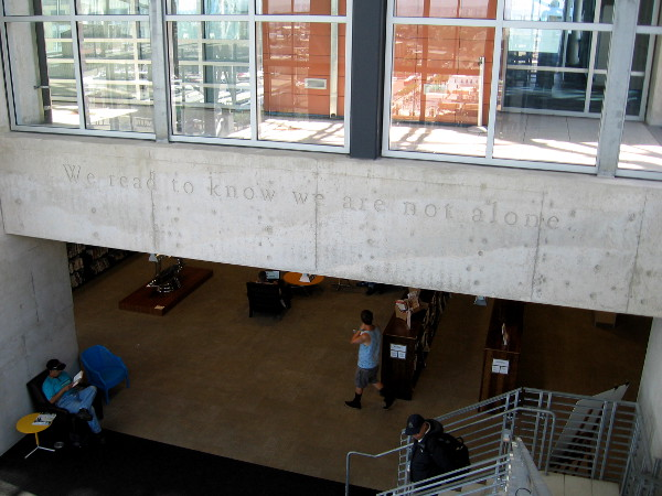 We read to know we are not alone. Wise words inscribed in the San Diego Central Library's large, friendly Reading Room.