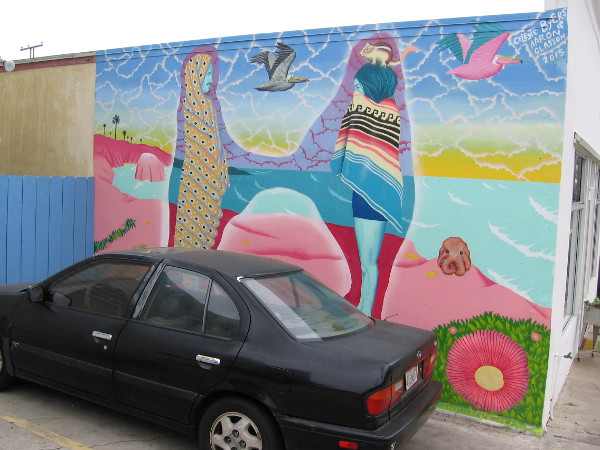 Cool street art mural on the side of a building near the foot of the OB pier.