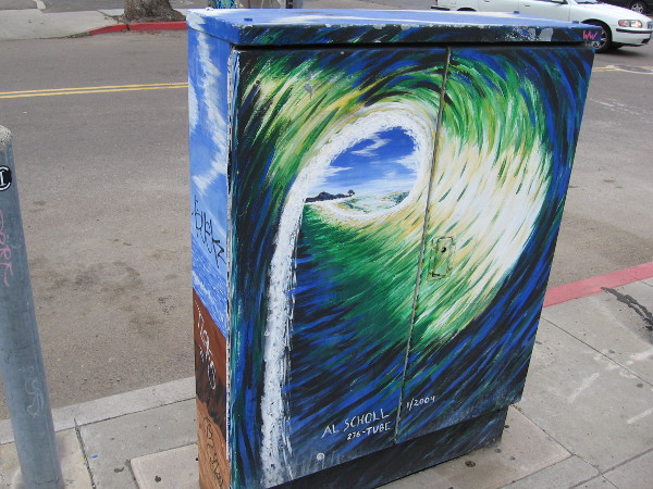 Surfing street art on OB utility box shows a view down the barrel of perfect wave.