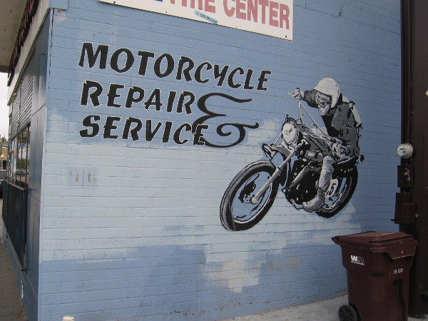 Motorcycle graphic on repair shop wall.