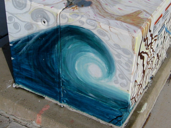 Another nearby box features street art in the form of a breaking ocean wave. Excellent surfing can be found nearby at Black's Beach.