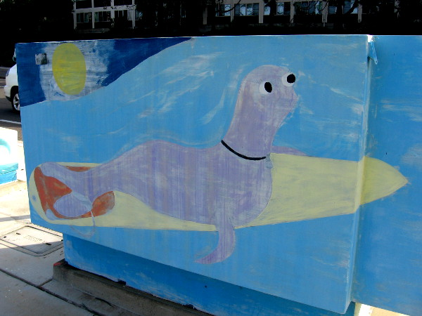 And lastly we see a purplish seal on a surfboard!