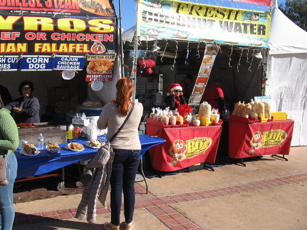 Look! Over there! I think I see Santa wearing sunglasses! Oops. Just a vendor selling treats during December Nights.