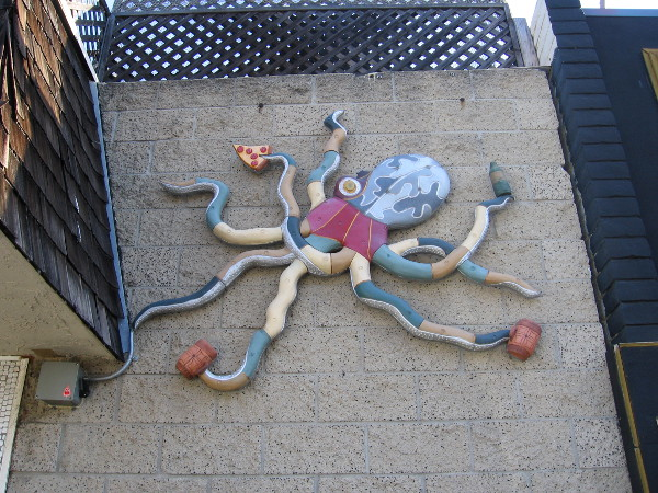 This octopus on Newport Avenue seems to enjoy beer and pizza. One can grab a lot with eight tentacles!