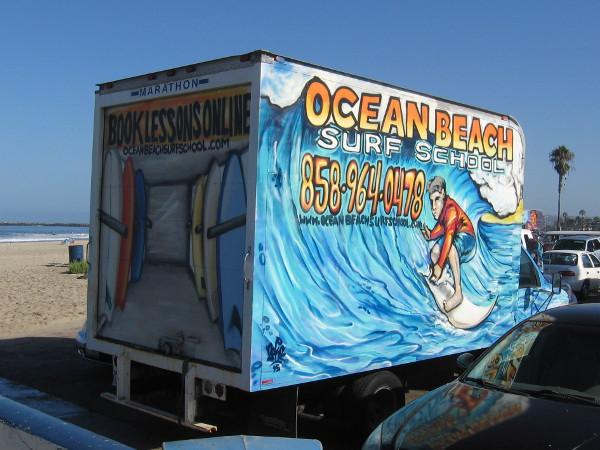 Ocean Beach Surf School truck features cool surfer art.