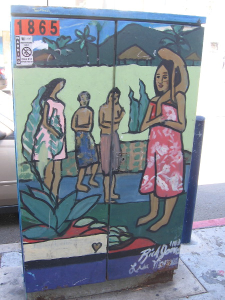 What appears to be a tropical island scene on a utility box in OB.